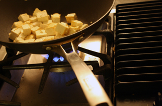 frying tofu cubes for pomegranate-chile tofu