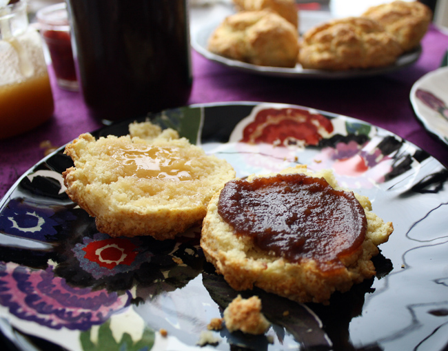 a biscuit with apple butter and honey