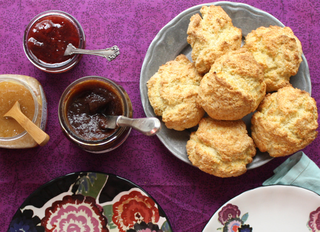 biscuits with apple butter, strawberry jam, and honey
