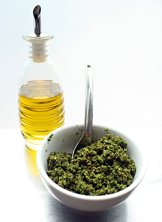 stirring olive oil into cilantro pesto mixture