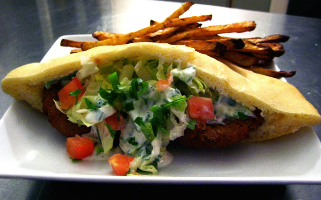 falafel stuffed in pita with tomatoes and tzatziki, plus a side of oven-baked fries