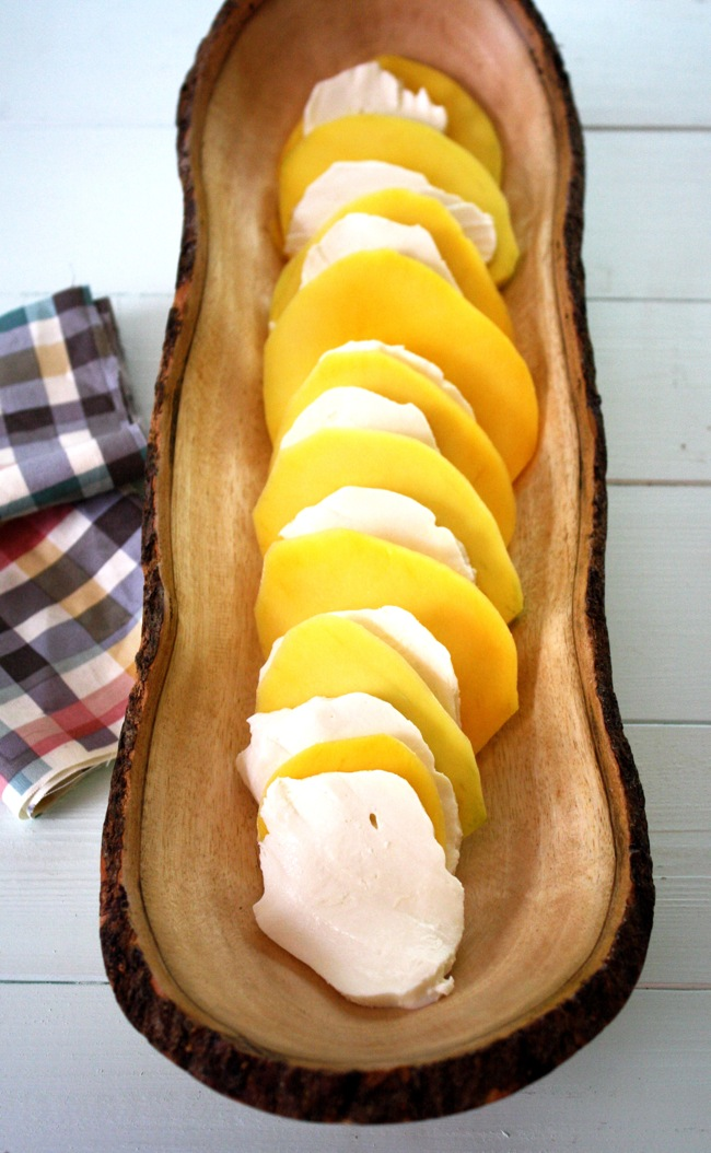 slices of mango and fresh mozzarella