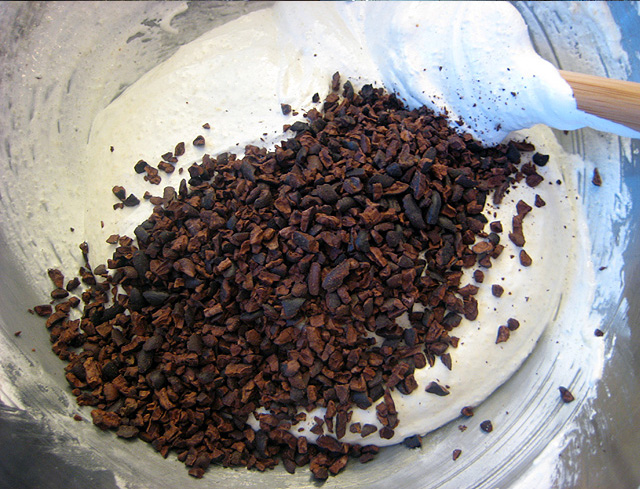 cacao nibs being folded into batter