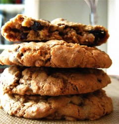 a stack of oatmeal chocolate cherry pecan cookies