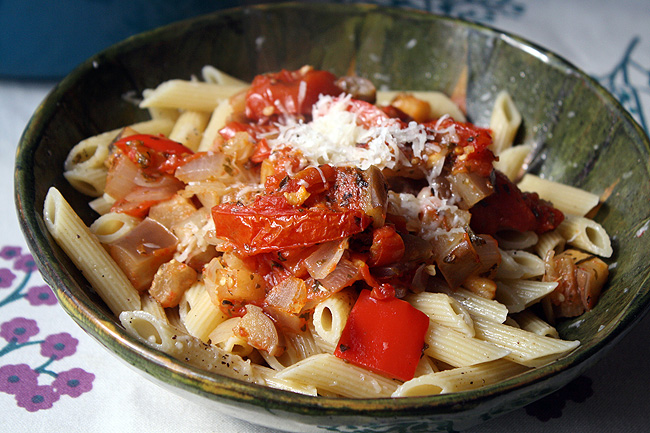 a bowl of pasta with ratatouille and parmesan