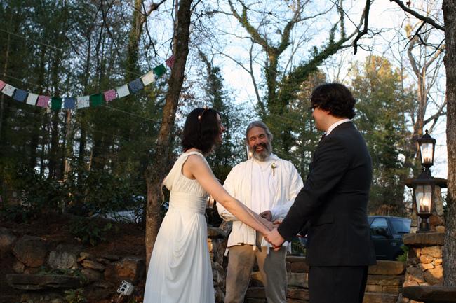 ceremony on the steps next to the koi pond