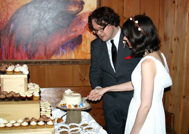 cutting our little cake as a grizzly bear looks on approvingly